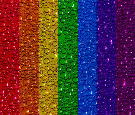 Condensed water droplets on a rainbow background photo