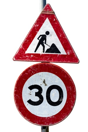 miry: A battered road works and speed limit sign