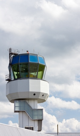 coordinate: Control tower of regional airport on a cloudy day