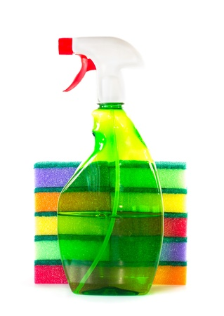 Spray bottle with cleaner for a stack of cleaning sponges photo