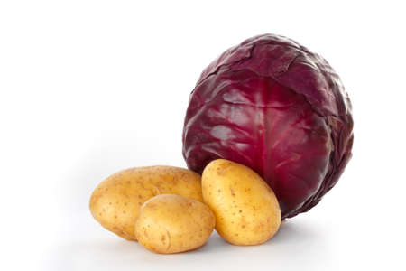 a whole red cabbage with three potatoes against a white background photo