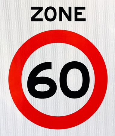 traffic rules: Traffic sign indicating entering a zone with a maximum speed of 60 Stock Photo