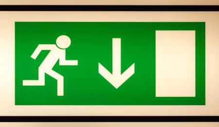 Closeup of illuminated emergency exit sign photo