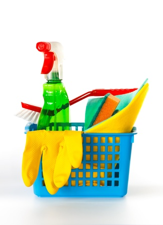 Several kitchen cleaning products in a basket on a white background photo