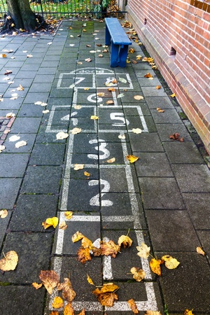 school playground: Hopscotch on the schoolyard in the autumn