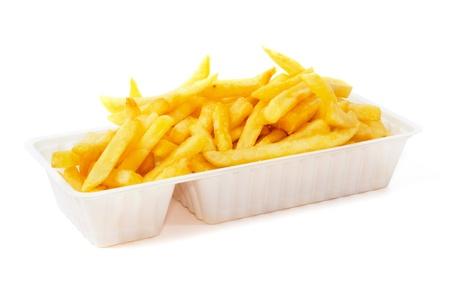 bandejas: Porci�n de papas fritas en la bandeja de pl�stico desechable Foto de archivo