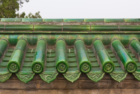 kaolin: Green glazed roof tiles on wall in China Stock Photo
