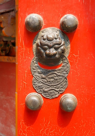 Traditional Chinese red door with a dragon (Jiaotu) head Stock Photo - 17831407