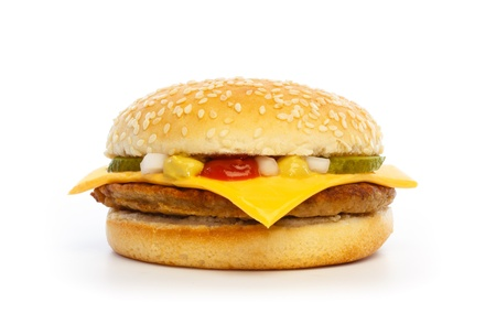Hamburger with cheese, pickles, onion and sauce on white background photo