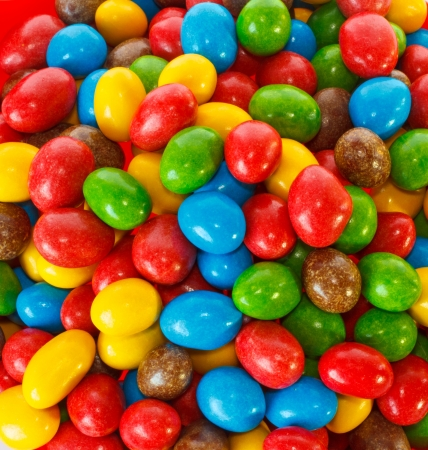 Top view of a pile of colorful chocolate candies photo