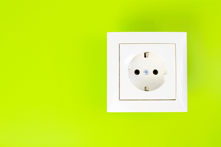 White European power socket on green background photo