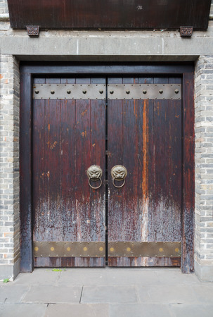 fittings: Brown traditional Chinese door with dragon doorknobs