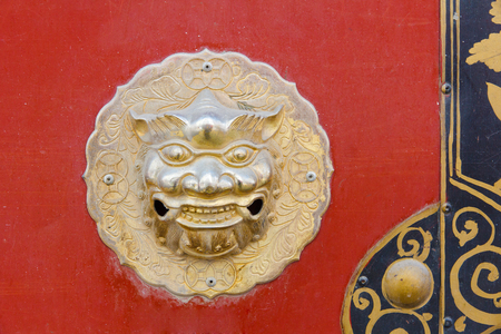 Detail of red Chinese door with dragon head photo