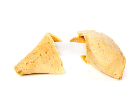 Opened fortune cookie without text against white background photo
