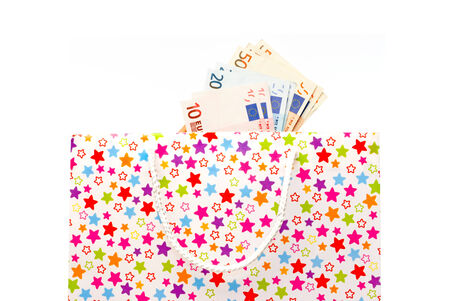Gift bag with euro banknotes against white background Stock Photo