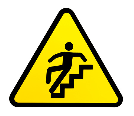tumble down: Yellow triangular sign warning for slippery stairs when wet Stock Photo