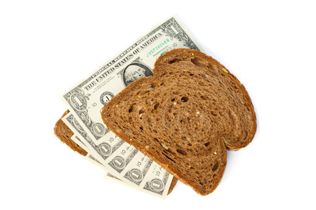 two us dollar: Two slices of bread topped with cash one US dollar bills Stock Photo