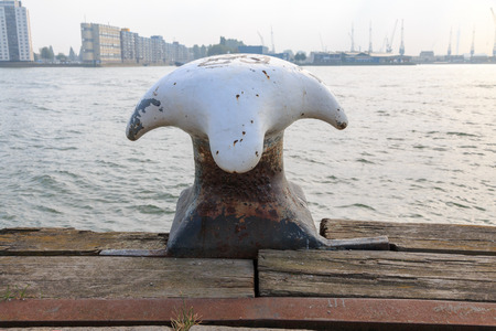maas: Rusty bollard by the river Nieuwe Maas in the city of Rotterdam, Netherlands