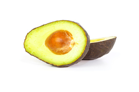 hass: Two halves of avocados with smooth creamy flesh against a white background