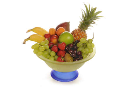 Mixed Fruit in glass bowlPineapple, banana, nectarine, apricot, cherry, strawberry and mango.Sudioaufnahme with weissenm background photo