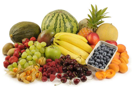 Melons, berries, various banana, nectarine, apricot, mango, pineapple, kiwi and grapes with white background taken in the studio photo