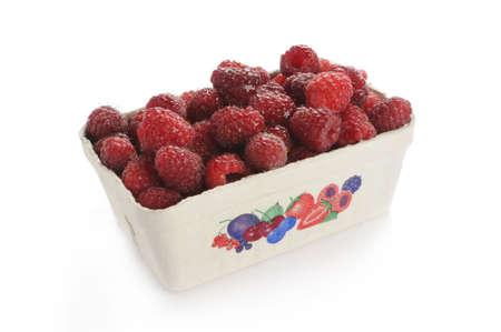rosoideae: Raspberry in a cardboard cup.Studio shot photographed with a white background