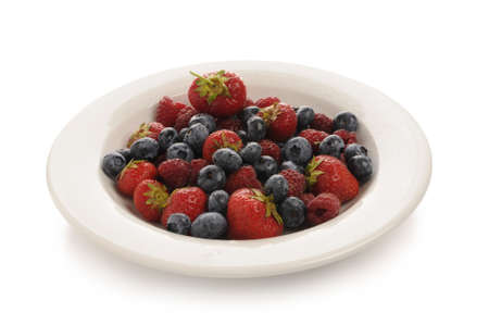 rosoideae: strawberries, blueberries and raspberries isolated on white background. Studio recording