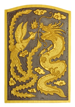 Dragon and swan carved pattern on the wooden texture photo
