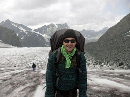 glasier: Mountaineer is walking on the glasier Kapchalskiy in Altay Mountains (Russia)