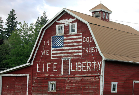 in god we trust: Patriotic Red Barn with Painted American Flag and In God We Trust