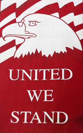 we: Banner Proclaiming United We Stand