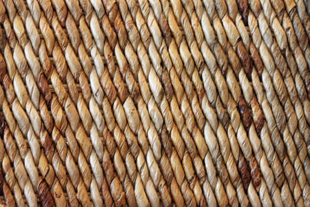 backgraound: Closeup of a Brown Woven Basket with Diagonal Stripes Stock Photo