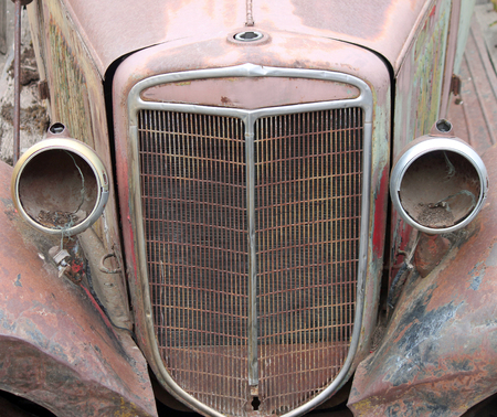 car grill: Closeup of a Vintage Car Grill with Headlights Missing Stock Photo
