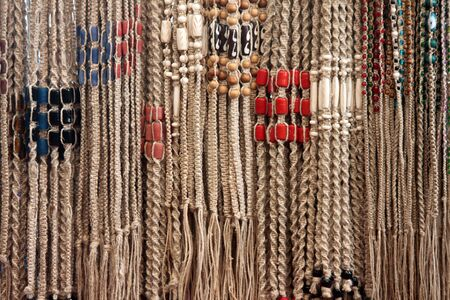 Woven Hemp Friendship Bracelets with Beads on Display at a Street Market