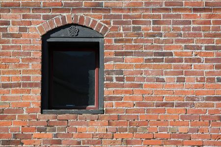 Closeup of a Window in a Red Brick Wall Stock fotó