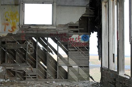 schoolhouse: Interior of an Abandonded Rural Schoolhouse with Graffiti