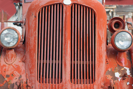 antique fire truck: Weathered Grill of a Red Vintage Fire Truck