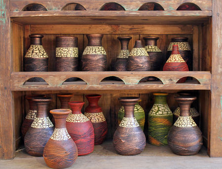 display case: Colorful Wooden Vases in a Wooden Display Case