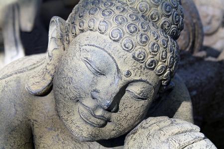 repose: Stone Carving of Buddha in Repose