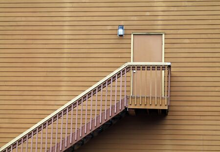 backdoor: Wooden Stairs Leading to a Door in the middle of a Wall