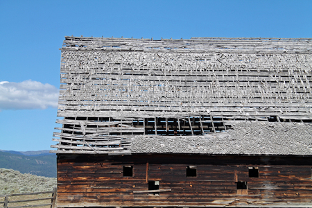 dilapidated: Rustic Barn with Dilapidated Roof in Sagebrush Country