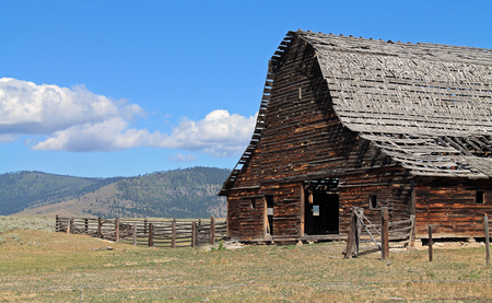 sagebrush: Rustic Barn with Dilapidated Roof in Sagebrush Country