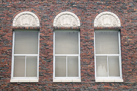 Three Windows in a Red Brick Building