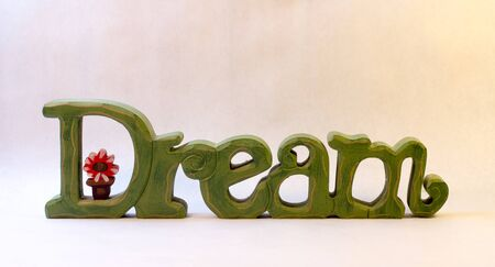 Green Wooden Sign Saying DREAM Banco de Imagens