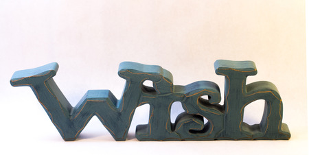 Blue Carved Wooden Sign that says Wish