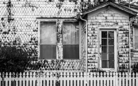 White Weathered House on the Coast with Decorative Siding