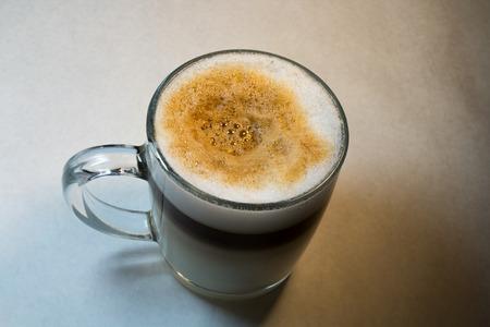 Double Latte with Foam in a Clear Glass Mug Stok Fotoğraf