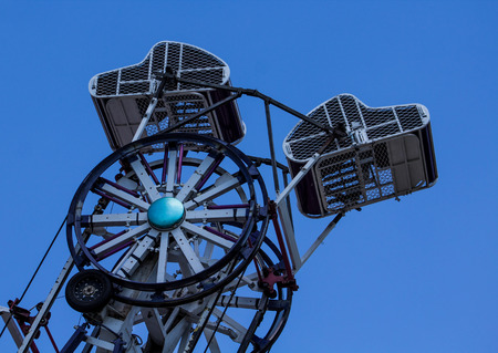 Carnival Ride at the Fair Against a Bright Blue Sky