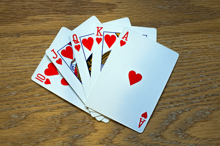 Closeup of Five Playing Cards - a Royal Flush in hearts