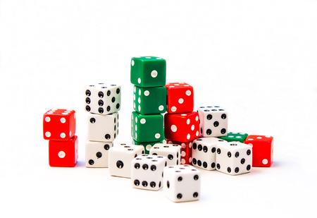 Several Stacks of Green, Red, and White Dice Cubes on a white background